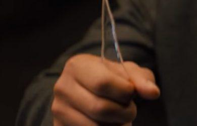 Blade Runner 2036 Screencap--hand holding glass shard